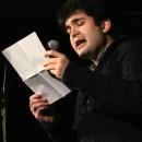 Emir Taghikani beim Poetry Slam Erlangen im Dezember 2013