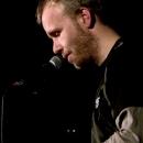 Finalist Robert Kayser  beim Poetry Slam Erlangen im Dezember 2013