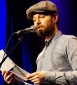 Patrick Salmen beim Poetry Slam in Erlangen im Januar 2016