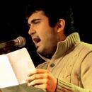 Emir Taghikhani beim Poetry Slam im März 2014