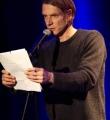Andreas Weber im Finale beim Poetry Slam in Erlangen im März 2015