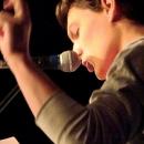 Max Schulle beim Poetry Slam Erlangen im November 2013
