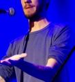 Bastian beim Poetry Slam im Oktober 2014